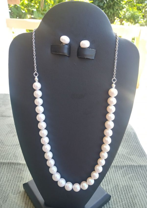 White culture pearl Necklace on a sterling silver chain with matching stub earrings