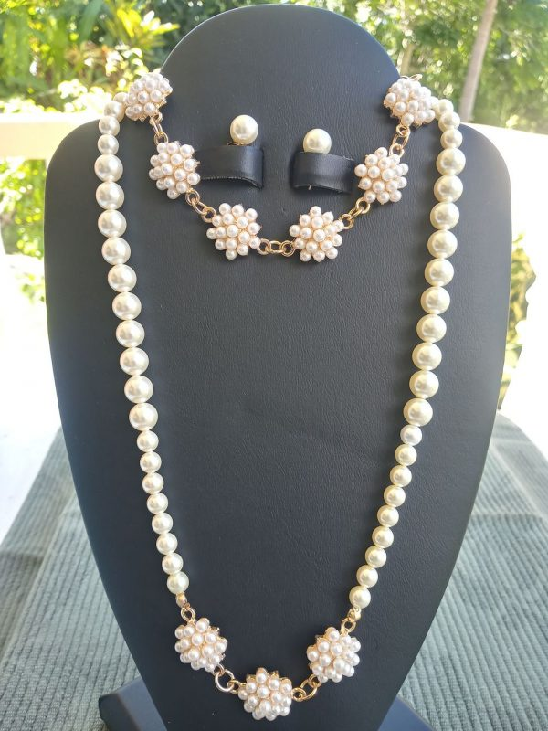 Off-white cluster pearl necklace with matching earrings and bracelet