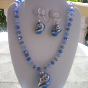 Blue beaded necklace with blue seashell pendant and matching earrings