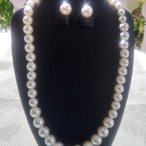 Swarovski cream pearl necklace with matching earrings