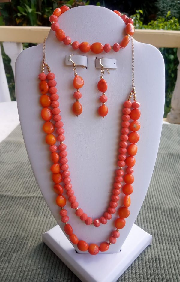 Coral and orange beaded necklace with matching earrings and bracelet