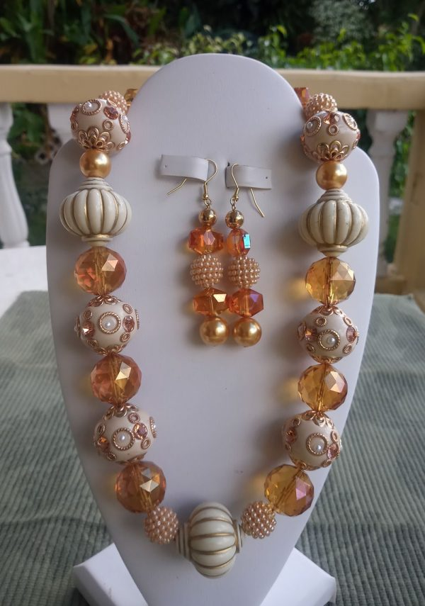 Cream and gold Indian style beaded necklace with amber crystal beads and gold pearls and matching earrings