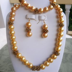 Gold pearl beaded necklace with matching earrings and bracelet