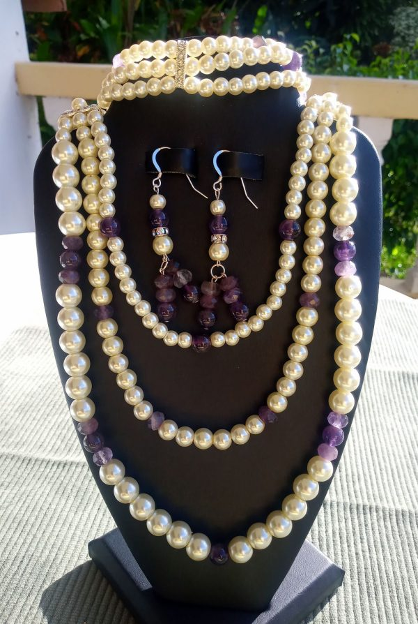 Ivory and amethyst beaded triple strand necklace with matching earrings and bracelet