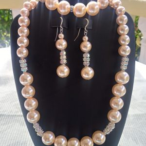 Peach pearl necklace with rhinestones and matching earrings and bracelet