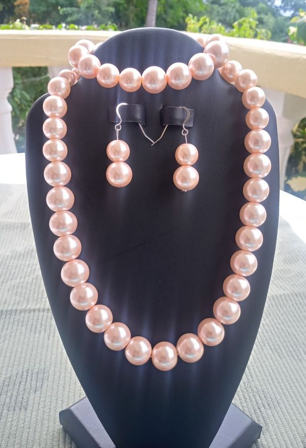 Pink pearl necklace with matching earrings and bracelet