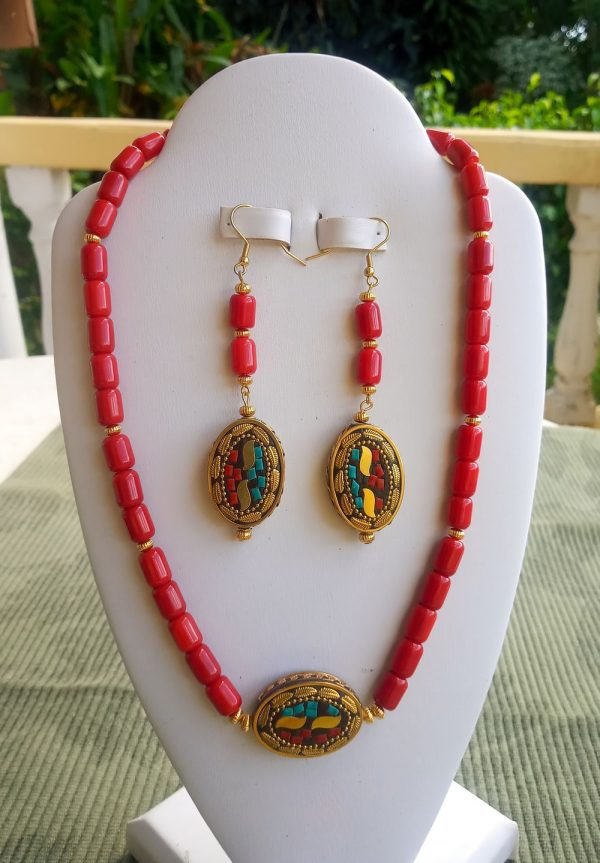Red bamboo beaded necklace with tibetan brass oval pendant and matching earrings